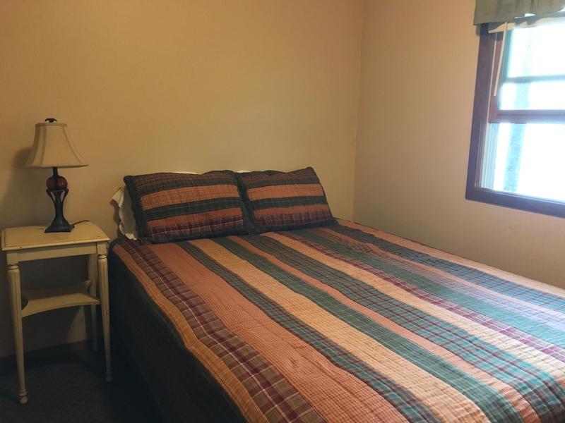 queen bed Bear Cottage Moonlight Bay Resort